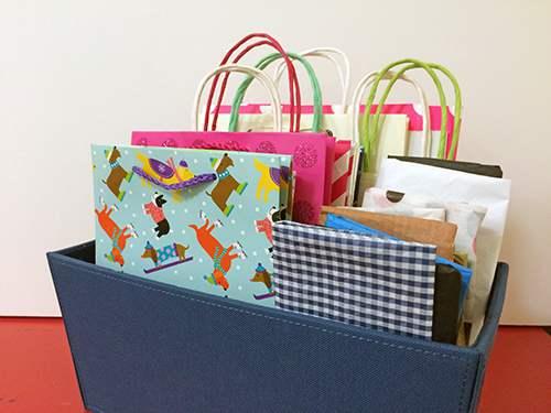 Gift bags organized in bin